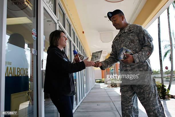 S Army recruiter Sergeant Eric Lamb speaks with Maria Balbonfin as he looks for prospective Army recruits on March 30 2009 in Miami Florida Military...