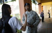 S Army recruiter Sergeant Eric Lamb speaks with Thawatchai Sarasap as he looks for prospective Army recruits on March 30 2009 in Miami Florida...