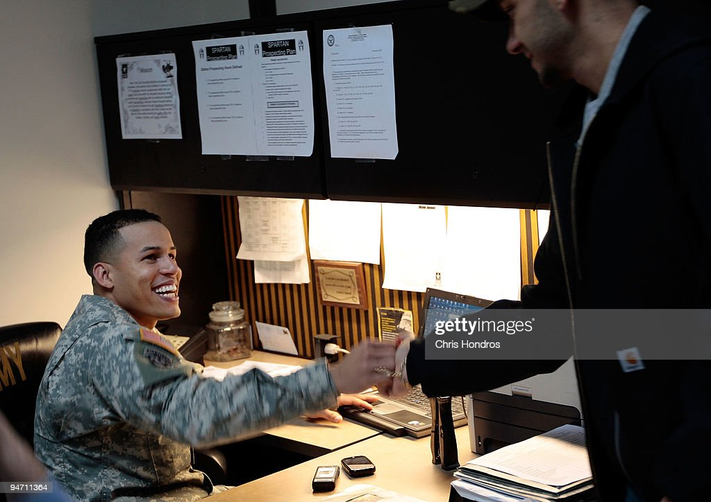 Army recruiter Staff Sgt Pablo Valdez Martinez smiles as he greets a potential Army recruit in the new office for the City Hall Recruiting Station...