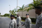 S Army recruiters Sergeant 1st class Marcus Lee Staff Sergeant Jason Battles Sergeant Tracy White and Sergeant Eric Lamb visit a shopping center for...