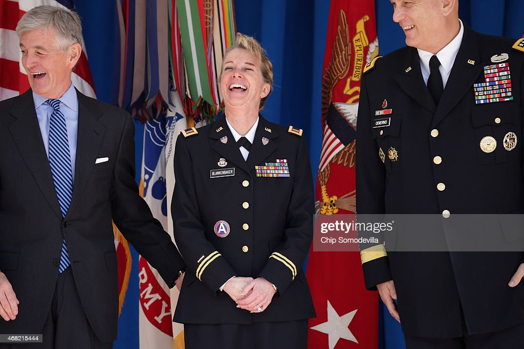 Army Secretary John McHugh, Chief Warrant Officer Five Debra Blankenbaker and Army Chief of Staff General Raymond Odierno share a laugh during the commencement ceremony for the U.S. Army's annual observance of Sexual Assault Awareness and Prevention Month in the Pentagon Center Courtyard March 31, 2015 in Arlington, Virginia. Blankenbaker was presented with the Department of Defense Sexual Assault Prevention Innovation Award for her work with the 7th Civil Support Command. In conjunction with the national campaign against sexual assault, The Army announced this year's theme, 'Not in My Squad. Not in Our Army. We are Trusted Professionals,' during the ceremony.