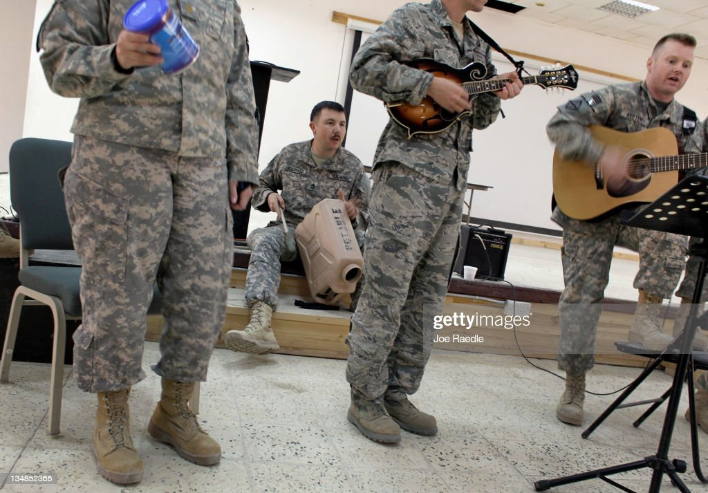 U.S. Army Sergeant 1st Class Perry Voorhess, Captain James Hughes from Mount Morris, Illinois and Major Shawn Keeter from Mayflower, Arkansas play in a church musical group called 'Potable Jug Band', during one of their last performances before heading back to the United States as the Army continues to send its soldiers and equipment home from Camp Adder as the base is prepared to be handed back to the Iraqi government later this month on December 4, 2011 in Nasiriyah, Iraq. Camp Adder is one of the few bases remaining that the United States controls as America's miilitary continues its pullout of the country by the end of this year, after eight years of war and the overthrow of Saddam Hussein.