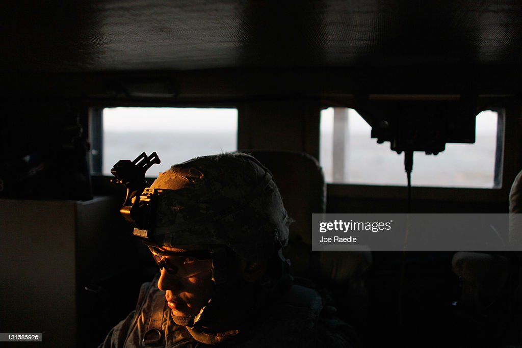 U.S. Army Sergeant Michael Keeler from Arlington, Nebraska of the 2-82 Field Artillery, 3rd Brigade, 1st Cavalry Division, rides in an armored truck as he returns to Camp Adder after conducting one of his last patrols as the Army continues to send its soldiers and equipment home and the base is prepared to be handed back to the Iraqi government later this month on December 3, 2011 at Camp Adder, near Nasiriyah, Iraq. The United States military continues its pullout of the country by the end of this year, after eight years of war and the overthrow of Saddam Hussein.