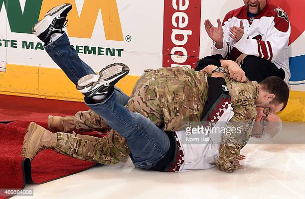 Army Sgt Daniel Urman surprises his father after returning home from Afghanistan prior to a game between the Arizona Coyotes and the Anaheim Ducks at...