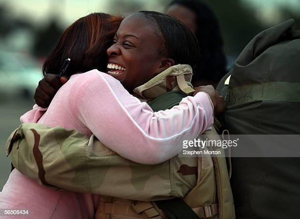 Army Sgt Kimberly Singletary is hugged by family friend Regina Ayala during a welcome home ceremony at Hunter Army Airfield December 30 2005 in...