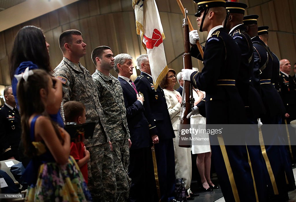 U.S. Army Sgt. Sean P. Karpf (3rd L) and Sgt. Cory A. Doane (4th L) stand at attention during the presentation of colors at a ceremony awarding them both the Purple Heart at Mount Vernon June 10, 2013 in Mount Vernon, Virginia. The U.S. Army celebrated its 238th birthday at the home of George Washington with a ceremony that included the awarding of the Purple Heart for three soldiers wounded in Afghanistan. Karpf received his injuries from an IED in Kandahar on June 15,, 2012; Doane received his injuries from an IED in Kandahar on July 3, 2012.