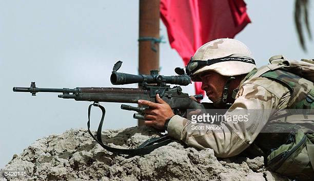 S Army sniper from the 1st Battalion 14th regiment of the 25th Infantry Division tries to get a lock on an enemy position during a battle with...