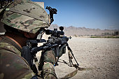 May 30, 2011 - U.S. Army sniper pulls security down a dusty road with an Mk14 EBR sniper rifle during a combat patrol outside of Combat Operating Post 8-1, in downtown Kandahar City, Afghanistan. The