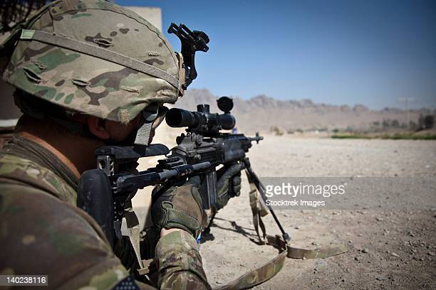 U.S. Army sniper pulls security using an Mk14 Enhanced Battle Rifle.