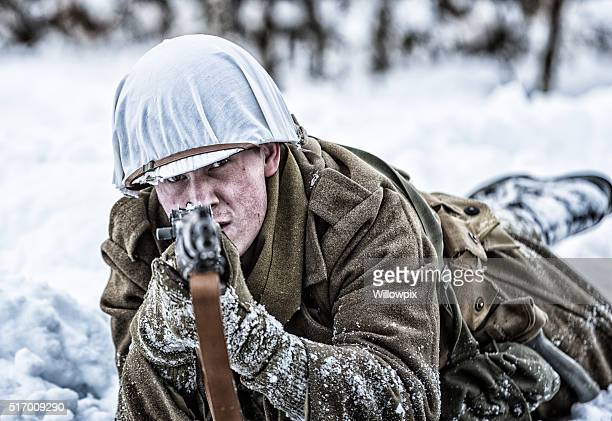 WWII US Army Sniper Soldier Aiming M1 Rifle in Winter
