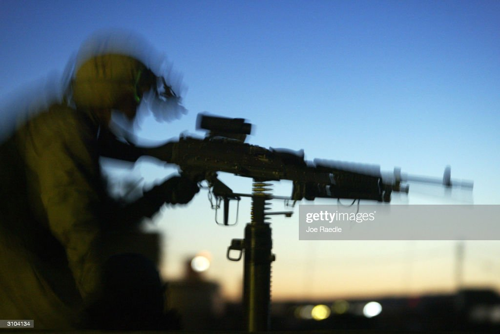 S Army soldier from the 101st Airborne Rakkassan regiment mans his M240 machine gun during a raid on a home October 30 2003 in Tallafar Iraq Acting...