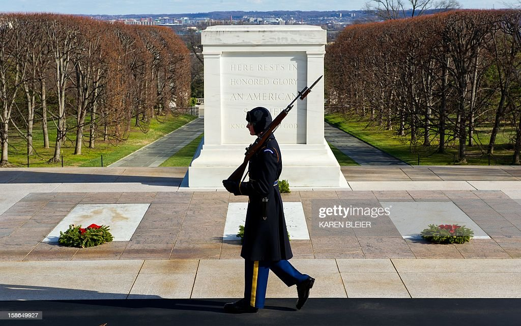 Army soldier, from the 3rd Infantry Regiment, walks his tour at the Tomb of the Unknowns at Arlington National Cemetery December 22, 2012 in Arlington, Virginia. The Army's 3rd Infantry Regiment, known as The Old Guard, has kept watch day and night over the site in Northern Virginia since 1948 without a moment's lapse. AFP PHOTO/Karen BLEIER