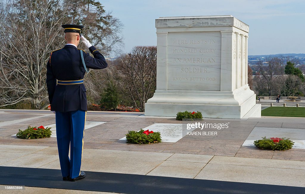 Army soldier from the 3rd United States Infantry Regiment, 'The Old Guard,' Tomb Guard, salutes at the Tomb of the Unknowns, December 25, 2012 in Arlington National Cemetery in Virginia. AFP PHOTO /Karen BLEIER