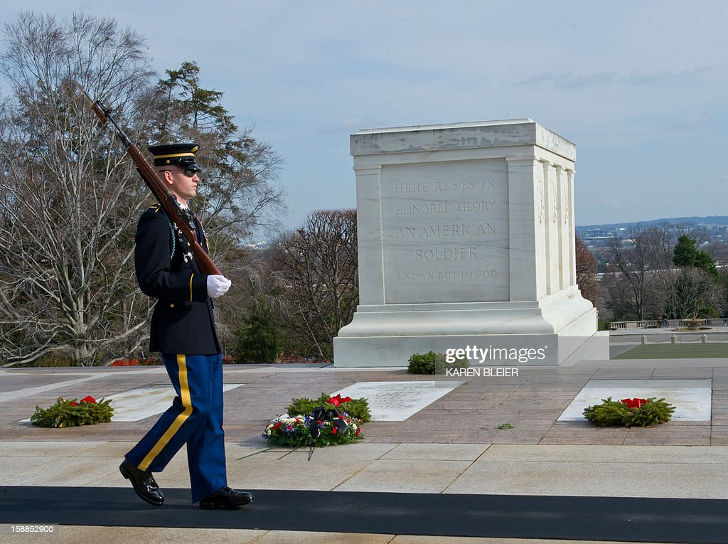 Army soldier from the 3rd United States Infantry Regiment, 'The Old Guard,' Tomb Guard, walks his post at the Tomb of the Unknowns, December 25, 2012 in Arlington National Cemetery in Virginia. AFP PHOTO /Karen BLEIER