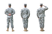 US Army soldier in three positions; Parade rest, Attention, Saluting. Back view, isolated on white background