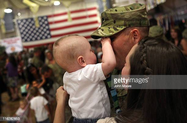 S Army soldier is greeted by his son after he and fellow troops arrived from Afghanistan on June 15 2011 to Fort Carson Colorado More than 500...
