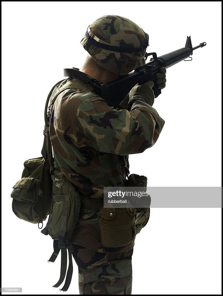 US army soldier pointing gun