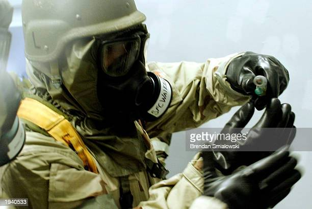 S Army soldier prepares to inject Atropine a nerve agent antidote kit into a mannequin during training April 19 2003 at Fort Leonard Woods Chemical...