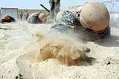 April 25, 2009 - Army soldier pulls himself through a 25 foot sandpit on a Defender Challenge course at an air base in Southwest Asia. Teams from different units ran the course, testing stamina, stren