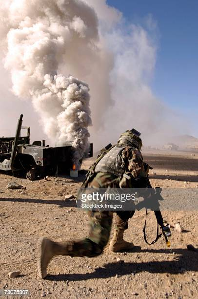 A U.S. Army Soldier reacts to a controlled explosion during training at the National Training Center on Fort Irwin, California, November 7, 2006.