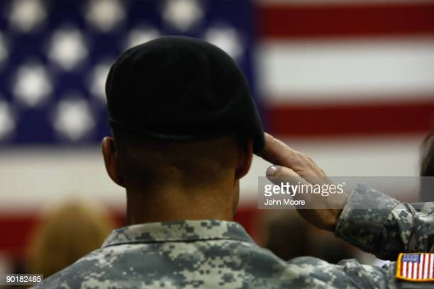 S Army soldier salutes during the national anthem as soldiers return home from Iraq on August 29 2009 in Fort Carson Colorado The last main body some...