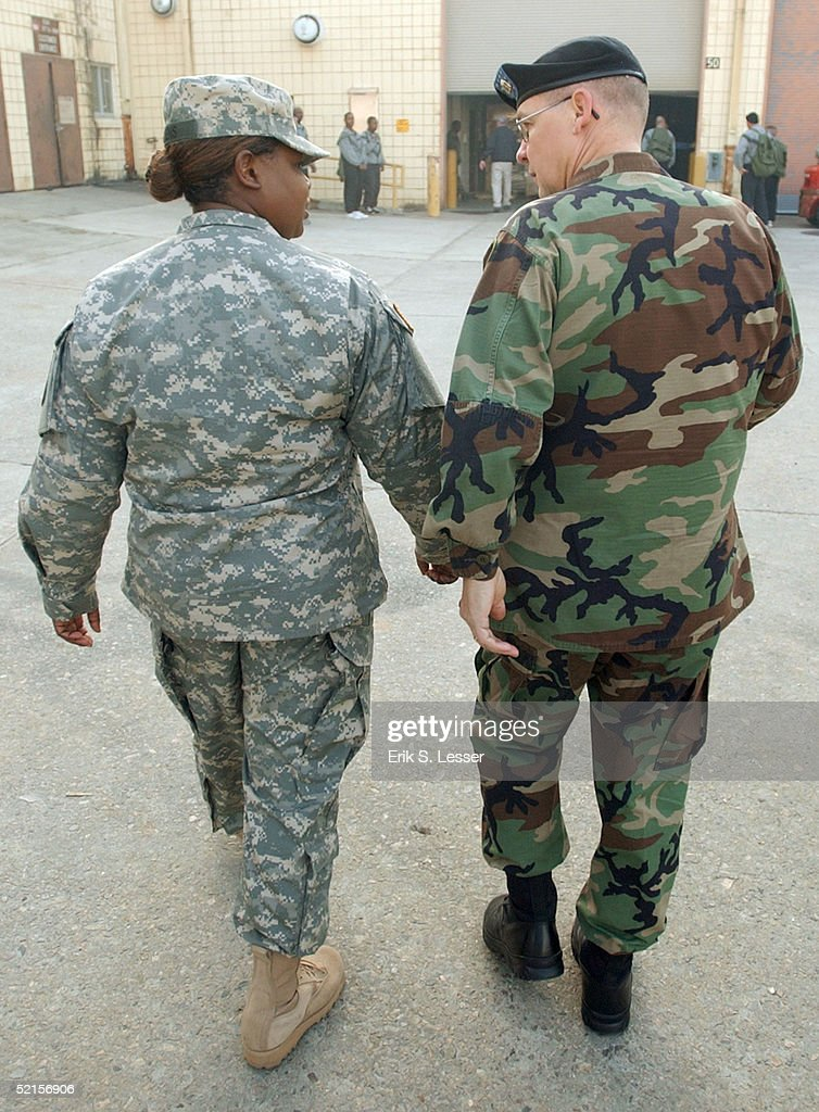 S. Army soldier with the Georgia National Guard's 48th Infantry Brigade wears the new Army Combat Uniform (ACU) (L) while talking with another soldier in the older Battle Dress Uniform (R) February 8, 2005 at Fort Stewart, Georgia. The ACU includes a new universal camouflage pattern and provides moisture wicking, functionality and ergonomics.