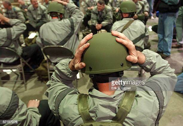 S Army soldier with the Georgia National Guard's 48th Infantry Brigade trys on his Advanced Combat Helmet while being issued the US Army's new Army...