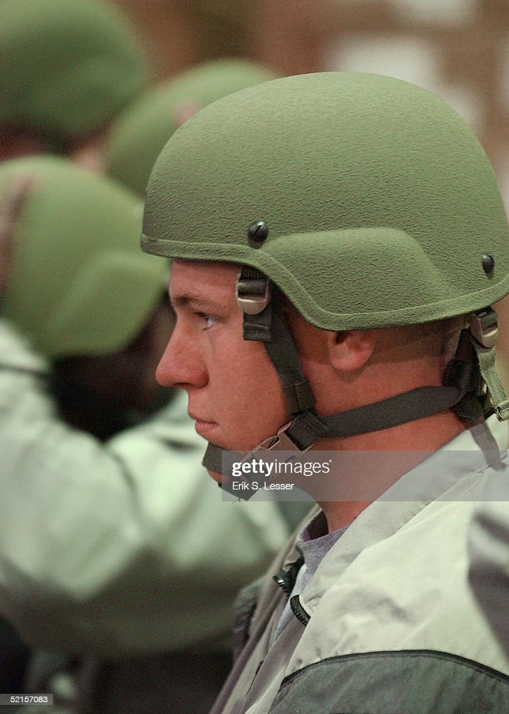 S. Army soldier with the Georgia National Guard's 48th Infantry Brigade trys on his Advanced Combat Helmet while being issued the U.S. Army's new Army Combat Uniform (ACU) February 8, 2005 at Fort Stewart, Georgia. The ACU includes a new universal camouflage pattern and provides moisture wicking, functionality and ergonomics.