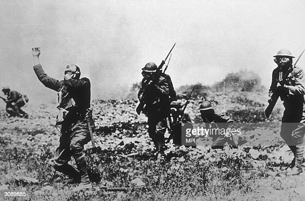 A soldier without a mask succumbs to the fumes in a posed gas attack in France during WWI