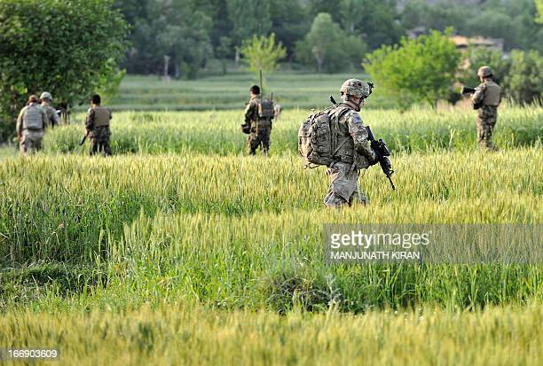US army soldiers along with the soldiers of Afghan National Army march from the Forward Base Honaker Miracle at Watahpur District in Kunar province...