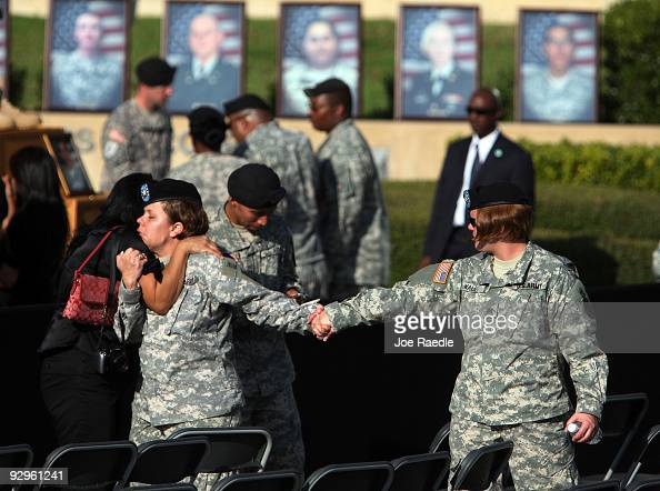 S Army soldiers and civilians grieve together during the memorial service that US President Barack Obama and first lady Michelle Obama attended in...