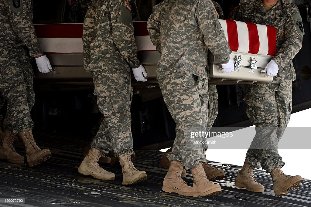 U.S. Army soldiers carry the flag-draped transfer case containing the remains of U.S. Army Staff Sgt., Christopher M. Ward during a dignified transfer at Dover Air Force Base, on April 8, 2013 in Dover, Delaware. Ward, who was from Oak Ridge, Tenn., was killed while supporting Operation Enduring Freedom - Afghanistan.