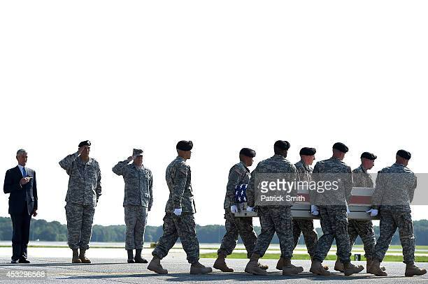 S Army soldiers carry the flagdraped transfer case containing the remains of US Army Maj Gen Harold J Greene during a dignified transfer as US Army...
