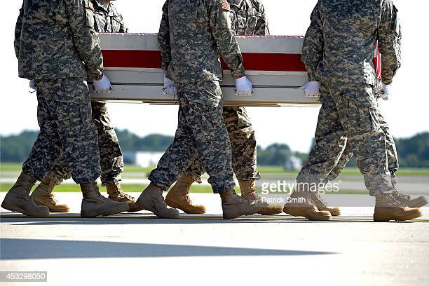 S Army soldiers carry the flagdraped transfer case containing the remains of US Army Maj Gen Harold J Greene during a dignified transfer at Dover Air...