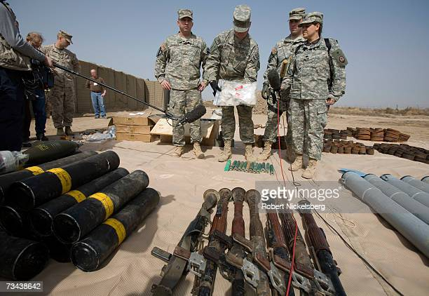 S Army soldiers display 120mm mortars RPG launchers 122 mm rockets from a large weapons cache of deadly armorpiercing bombs of a type Tehran has...