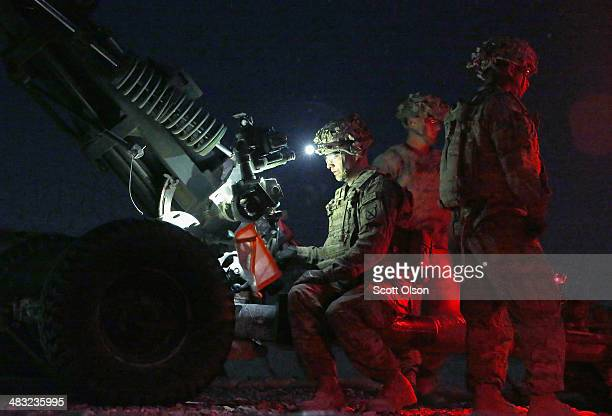 S Army soldiers fire illumination artillery rounds from a 105mm Howitzer at Forward Operating Base Shank on April 7 2014 near Pule Alam Afghanistan...
