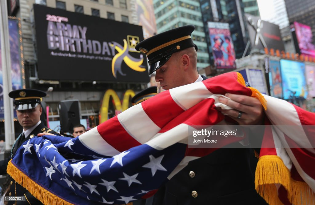 U.S. Army soldiers fold the U.S. flag after an event in Times Square marking the Army's 237th anniversary on June 14, 2012 in New York City. U.S. Army Chief of Staff Gen. Raymond Odierno swore in 16 new recruits during the celebration.