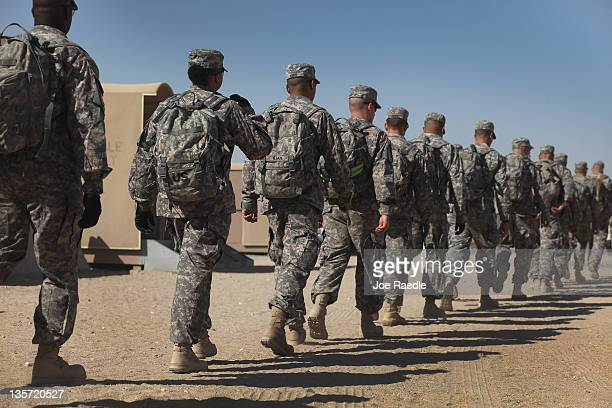 S Army soldiers from 112 1st Cavalry Division walk to the customs building as they prepare for the flight back to Fort Hood from Kuwait after exiting...