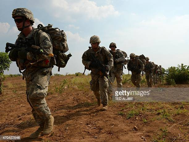 US army soldiers from 2nd Stryker Brigade Combat of the 5th Infantry Division based in Hawaii walk after disembarking from a CH47 Chinnok helicopter...