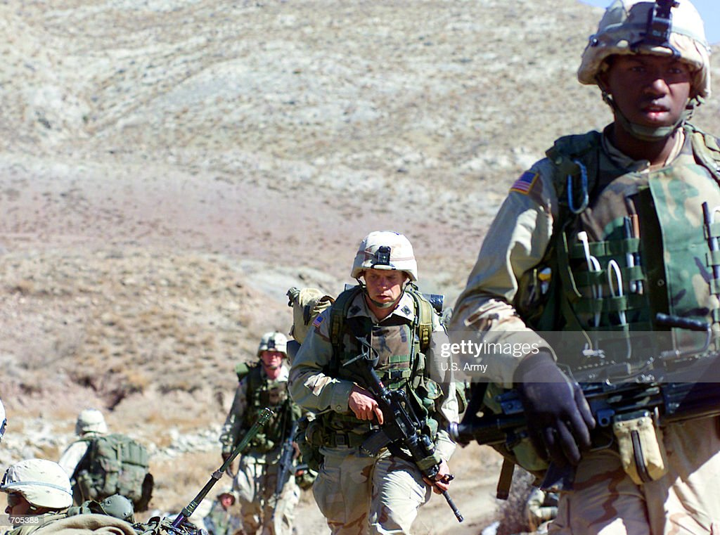 S Army soldiers from the 101st Airborne division move positions March 4 2002 in Eastern Afghanistan The soldiers were participating in the largest...
