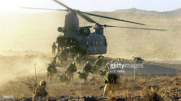 S Army soldiers from the 101st Airborne division off load during a combat mission from a Chinook 47 helicopter March 5 2002 in Eastern Afghanistan...