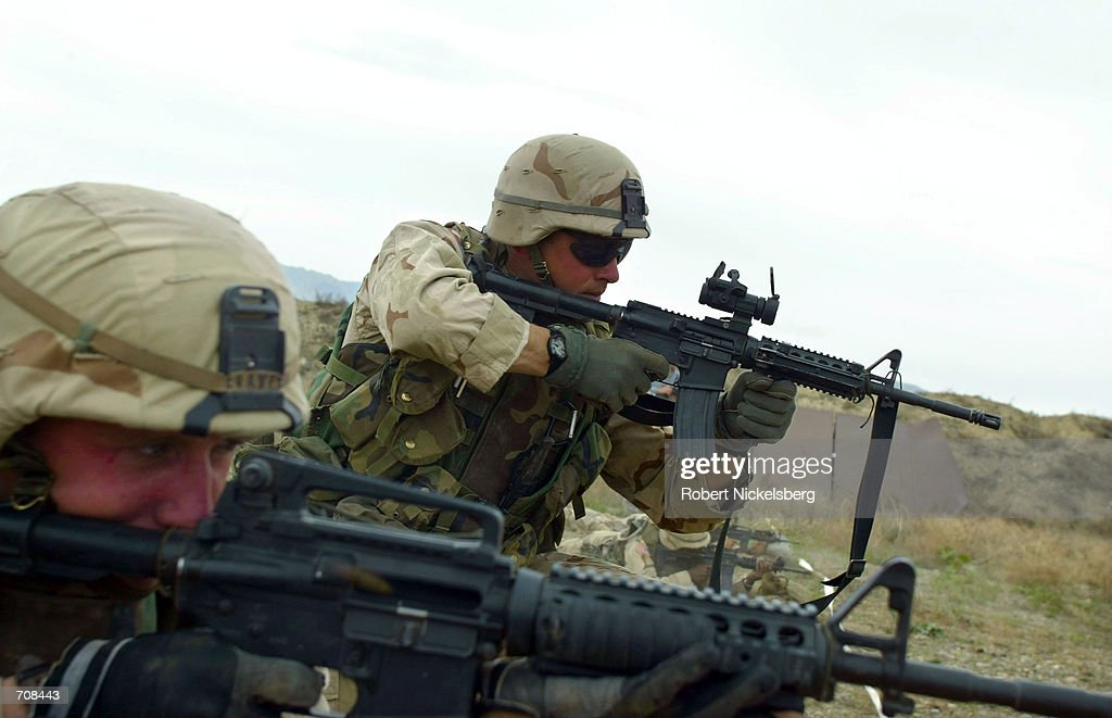 US army soldiers from the 101st Airborne Division practice firing their M16 rifles April 12 2002 at the Bagram Air Base firing range US troops are in...