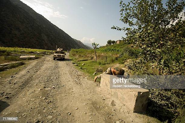 US Army soldiers from the 10th Mountain Division move up a dirt road from Naray Kunar to a Forward Operating Base in Kamdesh Nuristan August 24 in...