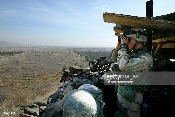 US Army soldiers from the 1st Battalion 501 Parachute Infantry Regiment watch the surrounding countryside from an observation post at Camp Salerno...