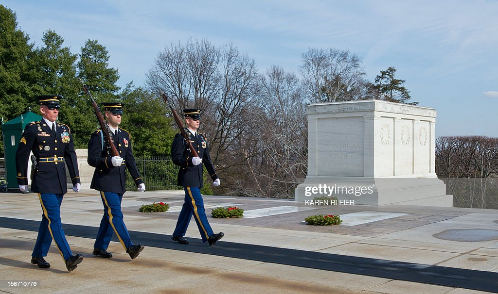 US Army soldiers from the 3rd United States Infantry Regiment, 'The Old Guard,' Tomb Guard, perform a changing of the guard at the Tomb of the Unknowns, December 25, 2012 in Arlington National Cemetery in Virginia. AFP PHOTO /Karen BLEIER
