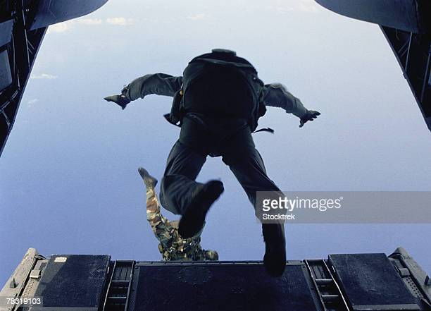US Army soldiers jumping out of aircraft
