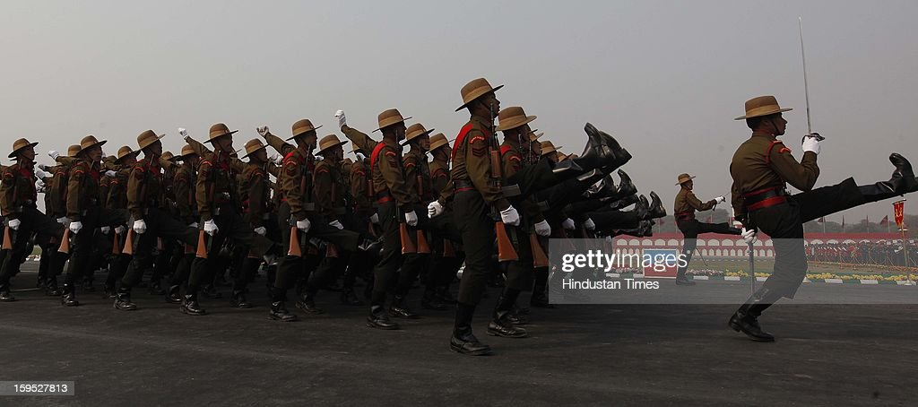 Army soldiers march during the Army Day parade At Delhi cant on January 15, 2013 in New Delhi, India. The 65th anniversary of the formation of the Indian national army was celebrated with soldiers from various regiments and artillery units taking part in a parade.