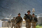 US army soldiers march from the Forward Base Honaker Miracle at Watahpur District in Kunar province during a joint patrol led by the Afghan National...