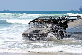 July 24, 2008 - U.S. Army soldiers offload a Humvee from a floating causeway during a Joint Logistics Over-The-Shore exercise at Red Beach, Camp Pendleton, California.