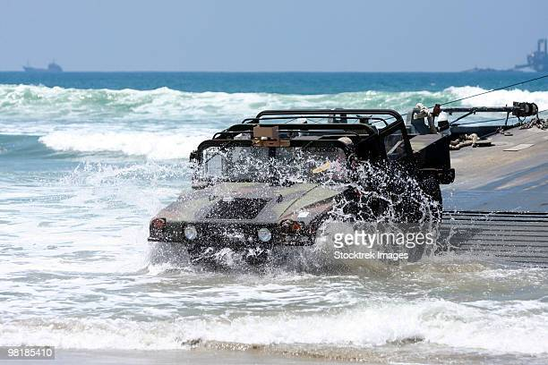 U.S. Army soldiers offload a Humvee from a floating causeway at Red Beach, Camp Pendleton, Californi
